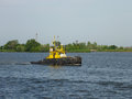 Kherson, Ukraine - June 5, 2014: An old Soviet tugboat on the Dnieper River.