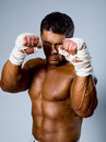 Kick boxer in fighting stance with his hands up Stock Images