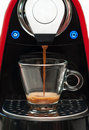 Kick starting the day coffee machine with a cup of espresso Stock Photo