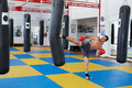 Kickbox fighter training with the punch bag Royalty Free Stock Photo