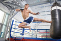 Kickboxer confident young training at the punching bag Royalty Free Stock Photography