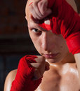 Kickboxer with hands in red bandages Royalty Free Stock Photo