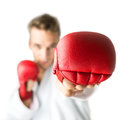 Kickboxer with red boxing gloves performing a martial arts punch Royalty Free Stock Photo