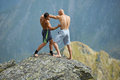 Kickboxers or muay thai fighters training on a mountain cliff sparring Royalty Free Stock Photo