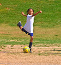 Kicking the Ball / Girl's Soccer Stock Image