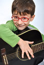 Kid with acoustic guitar Royalty Free Stock Photos