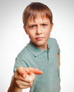 Kid angry boy shows his finger to screen evil is Royalty Free Stock Photo