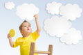 Kid attaching cloud to sky using ladder concept Royalty Free Stock Photo