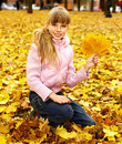 Kid in autumn orange leaves. Royalty Free Stock Photo