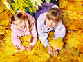Kid in autumn orange leaves. Royalty Free Stock Image