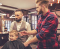 Kid at the barber shop Royalty Free Stock Photo