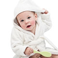 The kid in a bathrobe on white background Royalty Free Stock Image
