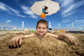Kid on the beach in sunny summer happy covered with sand Royalty Free Stock Image