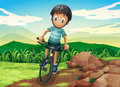 A kid biking at the hilltop illustration of Stock Photography