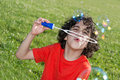 Kid Blowing Soap Bubbles in Summer Royalty Free Stock Photo