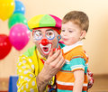 Kid boy with clown on birthday party Royalty Free Stock Photo