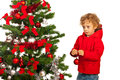Kid boy decorate tree christmas isolated on white background Royalty Free Stock Photography