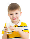 Kid boy drinking milk isolated on white Royalty Free Stock Image