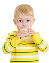 Kid boy drinking milk or yoghurt from glass Royalty Free Stock Images