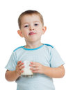 Kid boy drinking yogurt or kefir  on white Royalty Free Stock Photo