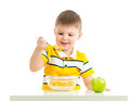Kid boy eating corn flakes with milk Royalty Free Stock Photo