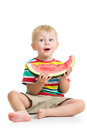 Kid boy eating watermelon with ripe Royalty Free Stock Images