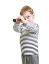 Kid boy looking ahead with telescope isolated Royalty Free Stock Images