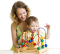 Kid boy and mother play with educational toy mom color Royalty Free Stock Image