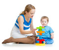 Kid boy and mother playing together with toy Royalty Free Stock Image