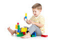 Kid boy playing with block toy over white background Royalty Free Stock Image