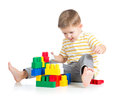 Kid boy playing with block toy over white background Stock Photos