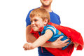 Kid boy playing superman wearing red cape