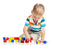 Kid boy playing toy blocks Royalty Free Stock Photo