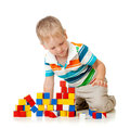 Kid boy playing wooden toys Stock Photo
