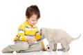 Kid boy and puppy dog little Stock Images