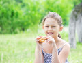 Kid and bun on outdoors Stock Photo