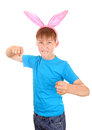 Kid with bunny ears threaten a fist isolated on the white background Royalty Free Stock Image