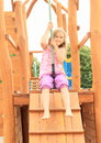 Kid on cableway little barefoot girl sitting and running kids Royalty Free Stock Photo