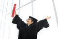 Kid celebrating graduating diploma Stock Image