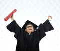 Kid celebrating graduating diploma Stock Photos