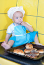 The kid chef with biscuits Stock Images