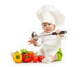 Kid in chef hat with healthy food vegetables Royalty Free Stock Image
