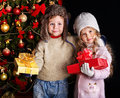 Kid with Christmas gift box. Royalty Free Stock Images