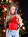 Kid with christmas gift box child near tree outdoor Stock Images