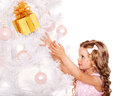 Kid with christmas gift box child near white tree isolated Stock Photo
