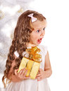 Kid with christmas gift box child near white tree isolated Royalty Free Stock Photos