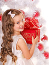 Kid with christmas gift box child near white tree isolated Royalty Free Stock Image