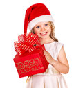 Kid with christmas gift box child in santa hat isolated Stock Image