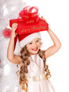 Kid with christmas gift box child in santa hat near white tree isolated Royalty Free Stock Photos