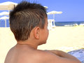 Kid contemplate the sea child beach Stock Photography